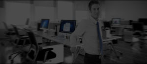 slider image of a nice office in the background with an internet marketing specialist in the foreground